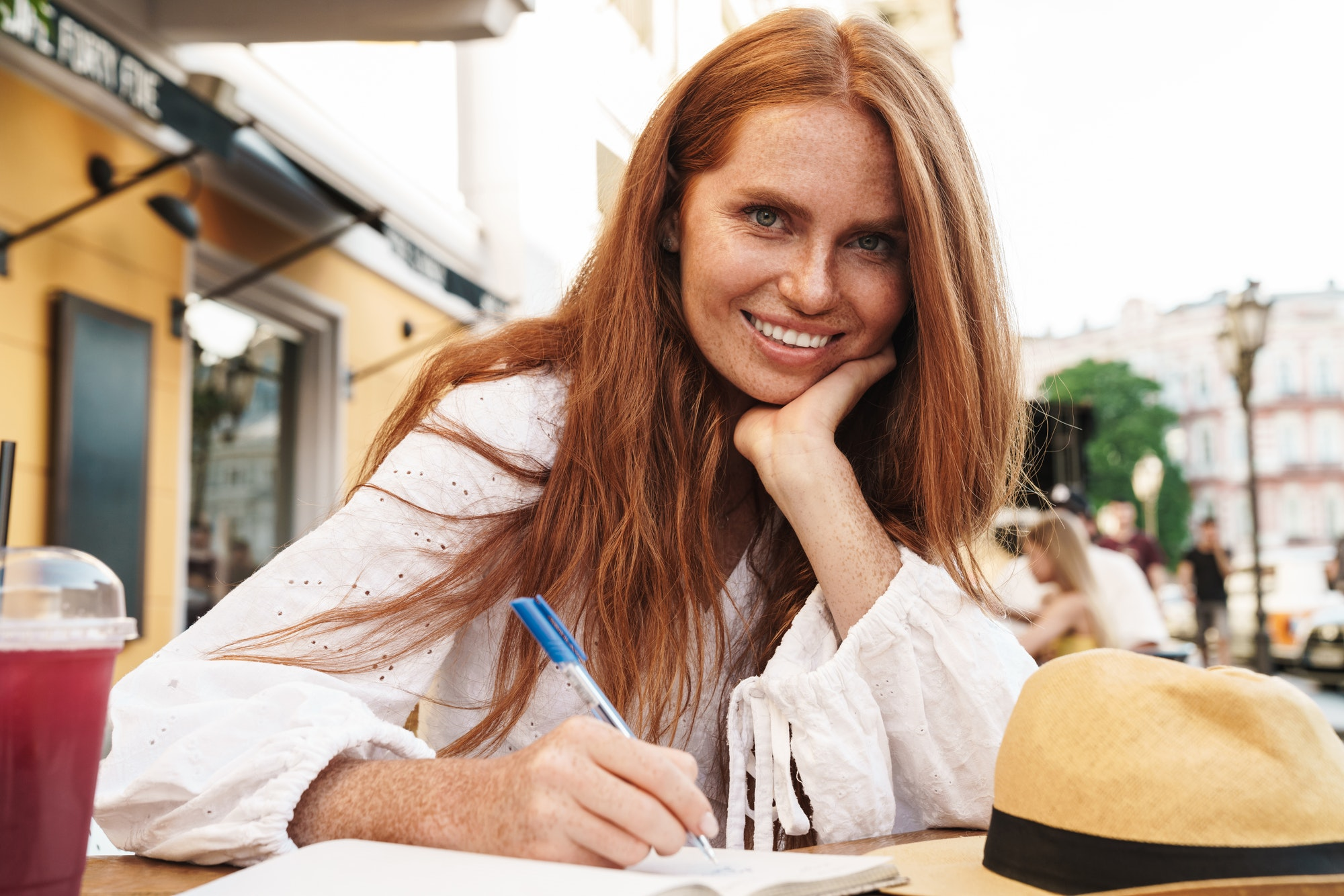 Close up of beautiful smiling red haired woman