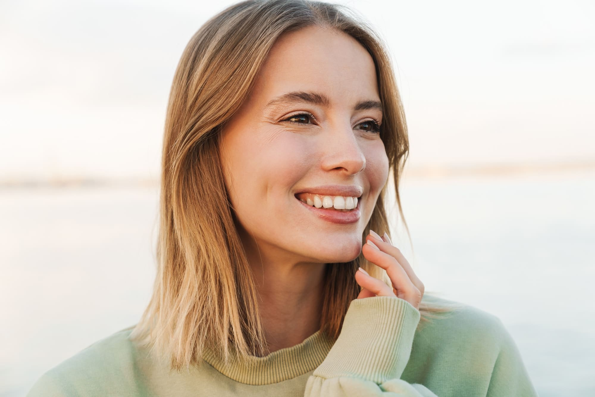 Portrait of happy woman smiling and looking aside